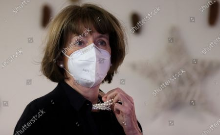 Stock Image of Henriette Reker, mayor of Cologne attends the first to be inoculated with a dose of the Pfizer-BioNTech Covid-19, corona virus vaccine at the Nursing home Riehl in Cologne, on December 27, 2020. - The European Union began a vaccine rollout, even as countries in the bloc were forced back into lockdown by a new strain of the virus, believed to be more infectious, that continues to spread from Britain. The pandemic has claimed more than 1.7 million lives and is still running rampant in much of the world, but the recent launching of innoculation campaigns has boosted hopes that 2021 could bring a respite.
