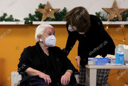 Henriette Reker (R), mayor of Cologne accompanies the 92 year old Gertrude Vogel (L) during the first to inoculated with a dose of the Pfizer-BioNTech Covid-19, corona virus vaccine at the Nursing home Riehl in Cologne, on December 27, 2020. - The European Union began a vaccine rollout, even as countries in the bloc were forced back into lockdown by a new strain of the virus, believed to be more infectious, that continues to spread from Britain. The pandemic has claimed more than 1.7 million lives and is still running rampant in much of the world, but the recent launching of innoculation campaigns has boosted hopes that 2021 could bring a respite.