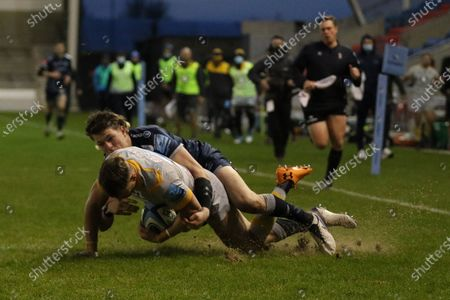 Wasp's Josh Bassett tackled by Sale Sharks Sam James  during the Gallagher Premiership Rugby match between Sale Sharks and Wasps at the AJ Bell Stadium, Eccles