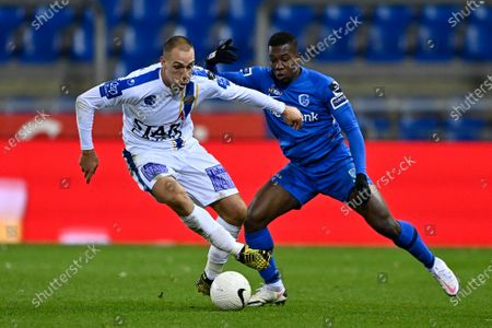 Stock Photo of Waasland-Beveren's Michael Frey and Genk's Carlos Cuesta fight for the ball during a soccer match between KRC Genk and Waasland-Beveren, Sunday 27 December 2020 in Genk, on day 19 of the 'Jupiler Pro League' first division of the Belgian championship.