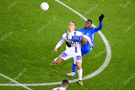 Waasland-Beveren's Michael Frey and Genk's Carlos Cuesta fight for the ball during a soccer match between KRC Genk and Waasland-Beveren, Sunday 27 December 2020 in Genk, on day 19 of the 'Jupiler Pro League' first division of the Belgian championship.