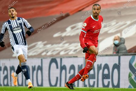 Liverpool defender Joel Matip (32) passes the ball during the Premier League match between Liverpool and West Bromwich Albion at Anfield, Liverpool