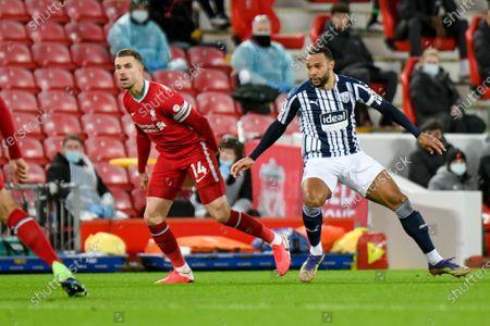 Liverpool midfielder Jordan Henderson (14) and West Bromwich Albion midfielder Matt Phillips (10) in action during the Premier League match between Liverpool and West Bromwich Albion at Anfield, Liverpool