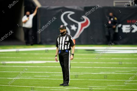 Back judge Greg Meyer (78) signals after a play during an NFL football game between the Cincinnati Bengals and the Houston Texans, in Houston