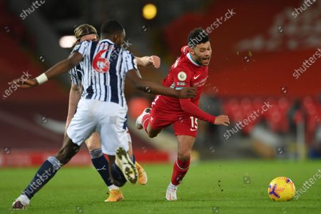 Liverpool's Alex Oxlade-Chamberlain, right, challenges for the ball during an English Premier League soccer match between Liverpool and West Bromwich Albion at the Anfield stadium in Liverpool, England