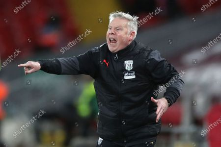 West Bromwich Albion's assistant coach and former Liverpool player Sammy Lee reacts during an English Premier League soccer match between Liverpool and West Bromwich Albion at the Anfield stadium in Liverpool, England