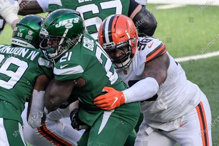 Stock Picture of Cleveland Browns defensive tackle Sheldon Richardson (98) tackles New York Jets' Frank Gore (21) during the first half of an NFL football game, in East Rutherford, N.J
