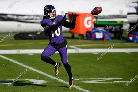 Baltimore Ravens wide receiver Chris Moore works out prior to an NFL football game against the New York Giants, in Baltimore