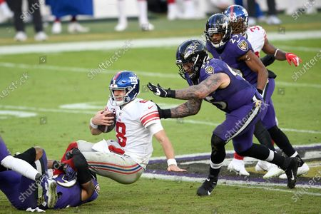 New York Giants quarterback Daniel Jones (8) is sacked by Baltimore Ravens linebacker Chris Board, let, as defensive end Derek Wolfe (95) helps bring him down during the second half of an NFL football game, in Baltimore. The Ravens won 27-13