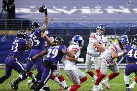 New York Giants quarterback Daniel Jones (8) has pass blocked by Baltimore Ravens defensive end Derek Wolfe (95) during the second half of an NFL football game, in Baltimore