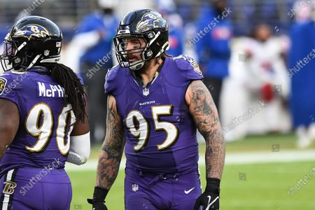 Stock Photo of Baltimore Ravens defensive end Derek Wolfe (95) looks on during the second half of an NFL football game against the New York Giants, in Baltimore