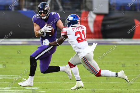 Baltimore Ravens tight end Mark Andrews (89) catches the ball against New York Giants safety Jabrill Peppers (21) during the second half of an NFL football game, in Baltimore