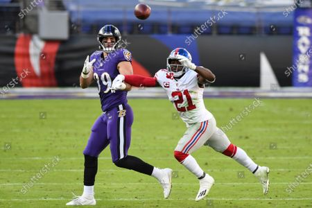 Baltimore Ravens tight end Mark Andrews (89) competes for the ball against New York Giants safety Jabrill Peppers (21) during the second half of an NFL football game, in Baltimore