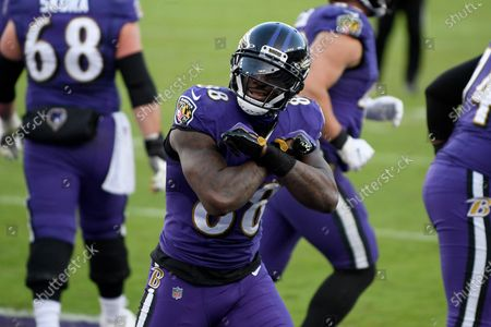 Baltimore Ravens wide receiver Dez Bryant (88) reacts after catching a touchdown pass from quarterback Lamar Jackson, not visible, against the New York Giants during the second half of an NFL football game, in Baltimore