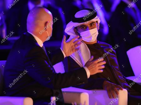 FIFA President Gianni Infantino (L) and Sheikh Mansour bin Mohammed bin Rashid Al Maktoum (R) attend a session at the 2020 Dubai Football Gala & Globe Soccer Awards Ceremony as part of the Globe Soccer Conference during the 15th edition of Dubai International Sports Conference at Armani Luxury Hotel in Dubai, United Arab Emirates, 27 December 2020.