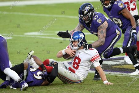 Stock Picture of New York Giants quarterback Daniel Jones (8) is sacked by Baltimore Ravens linebacker Chris Board, let, as defensive end Derek Wolfe (95) helps bring him down during the second half of an NFL football game, in Baltimore. The Ravens won 27-13