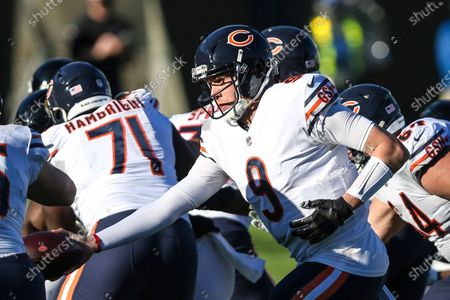 Chicago Bears quarterback Nick Foles (9) hands off the ball during the second half of an NFL football game against the Jacksonville Jaguars, in Jacksonville, Fla. Bears won 41-17