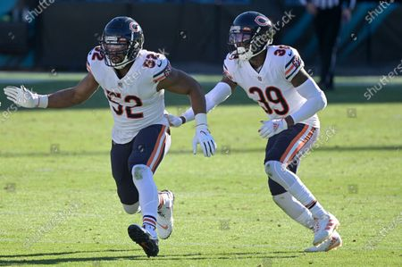 Chicago Bears linebacker Khalil Mack (52) and safety Eddie Jackson (39) follow a play during the second half of an NFL football game against the Jacksonville Jaguars, in Jacksonville, Fla