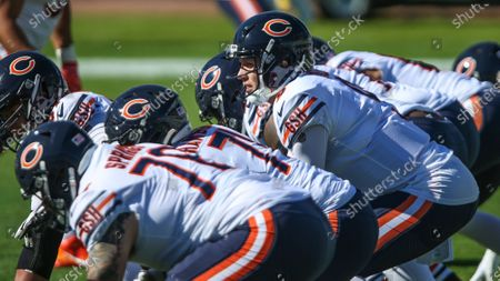 Chicago Bears quarterback Nick Foles (9) takes a snap during warm-ups before an NFL football game against the Jacksonville Jaguars, in Jacksonville, Fla. Bears won 41-17