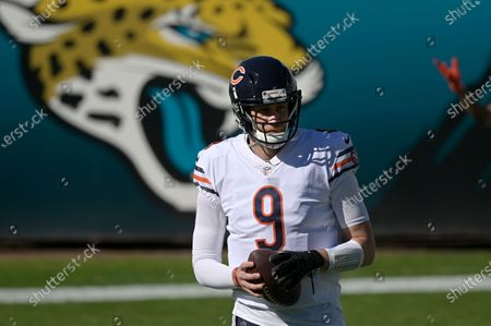 Chicago Bears quarterback Nick Foles (9) warms up before an NFL football game against the Jacksonville Jaguars, in Jacksonville, Fla
