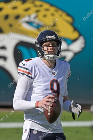 Chicago Bears quarterback Nick Foles warms up before an NFL football game against the Jacksonville Jaguars, in Jacksonville, Fla