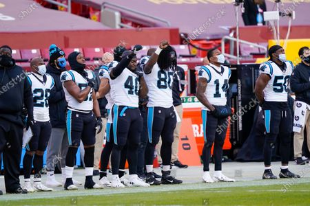Carolina Panthers fullback Alex Armah (40) and tight end Ian Thomas (80) raise their fist in the air before the start of the first half of an NFL football game against the Washington Football Team, in Landover, Md