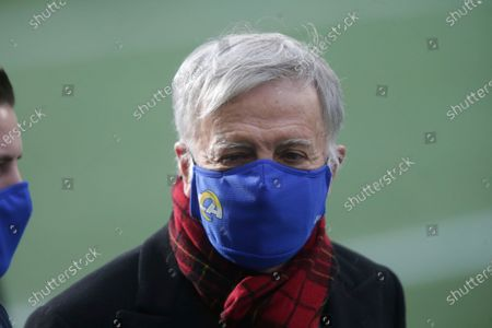 Stock Picture of Los Angeles Rams owner Stan Kroenke wears a mask before an NFL football game against the Seattle Seahawks, in Seattle