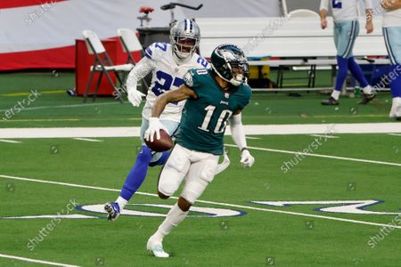 Philadelphia Eagles wide receiver DeSean Jackson (10) runs for a touchdown while being chased by Dallas Cowboys cornerback Trevon Diggs (27) during the first half of an NFL football game in Arlington, Texas, Sunday, Dec. 27. 2020
