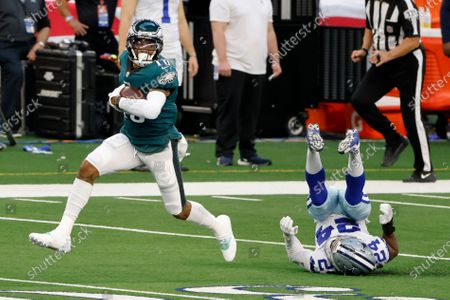 Philadelphia Eagles wide receiver DeSean Jackson (10) avoids a tackle attempt by Dallas Cowboys cornerback Chidobe Awuzie (24) and scores a touchdown in the first half of an NFL football game in Arlington, Texas, Sunday, Dec. 27. 2020