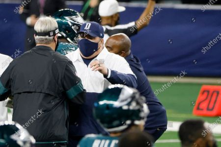 Stock Photo of Dallas Cowboys head coach Mike McCarthy and Philadelphia Eagles head coach Doug Pederson meet each other on the field after an NFL football game in Arlington, Texas, Sunday, Dec. 27. 2020. The Cowboys beat the Eagles 37-17