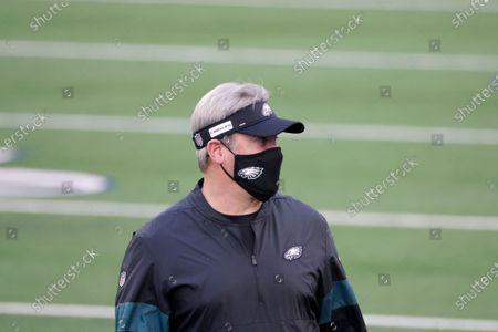Philadelphia Eagles head coach Doug Pederson watches warmups before an NFL football game against the Dallas Cowboys in Arlington, Texas, Sunday, Dec. 27. 2020