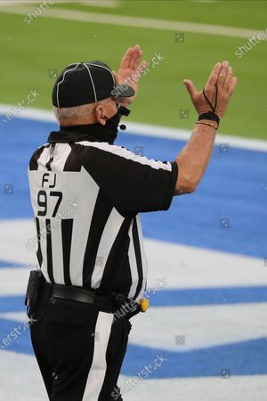 Field judge Tom Hill (97) signals a good kick during an NFL football game between the Denver Broncos and the Los Angeles Chargers, in Inglewood, Calif
