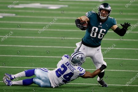Philadelphia Eagles tight end Zach Ertz (86) is stopped after catching a pass by Dallas Cowboys cornerback Chidobe Awuzie (24) in the second half of an NFL football game in Arlington, Texas, Sunday, Dec. 27. 2020