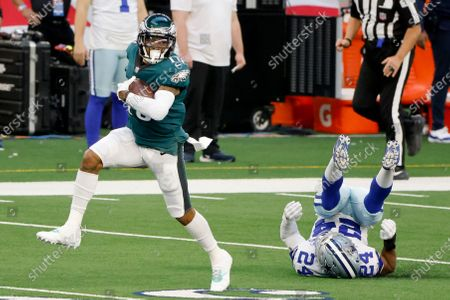 Philadelphia Eagles' DeSean Jackson (10) catches a long pass and gets past Dallas Cowboys cornerback Chidobe Awuzie (24) on his way to the end zone for a touchdown in the first half of an NFL football game in Arlington, Texas, Sunday, Dec. 27. 2020