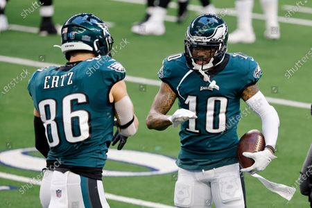 Philadelphia Eagles tight end Zach Ertz (86) and DeSean Jackson (10) celebrate a touchdown scored by Jackson on a long catch in the first half of an NFL football game against the Dallas Cowboys in Arlington, Texas, Sunday, Dec. 27. 2020