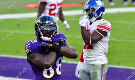 Baltimore Ravens wide receiver Dez Bryant (88) reacts after an 8-yard touchdown pass against the New York Giants during the second half at M&T Bank Stadium in Baltimore, Maryland, on Sunday, December 27, 2020. Baltimore defeated New York 27-13.