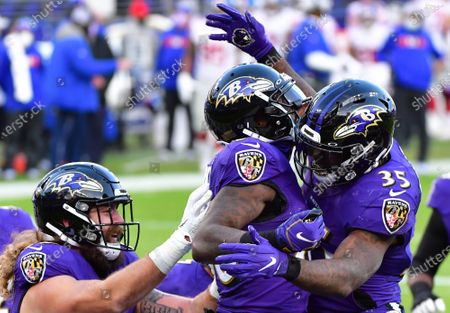 Baltimore Ravens wide receiver Dez Bryant (C) celebrates with Gus Edwards (35) and Eric Tomlinson (L) after an 8-yard touchdown pass against the New York Giants during the second half at M&T Bank Stadium in Baltimore, Maryland, on Sunday, December 27, 2020. Baltimore defeated New York 27-13.