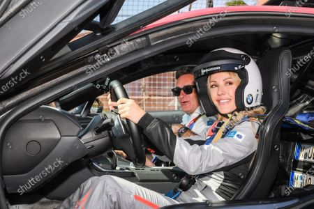 Singer Ellie Goulding with Alejandro Agag, Chairman of Formula E in the BMW i8 Safety car