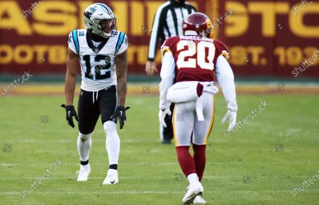Washington Football Team wide receiver Tony Brown (12) lines up against Washington Football Team cornerback Jimmy Moreland (20) during an NFL football game against the Carolina Panthers, in Landover, Md