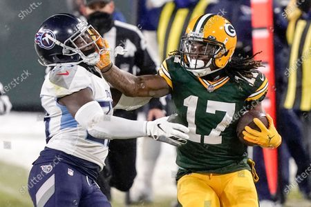 Green Bay Packers' Davante Adams tries to get past Tennessee Titans' Malcolm Butler during the second half of an NFL football game, in Green Bay, Wis