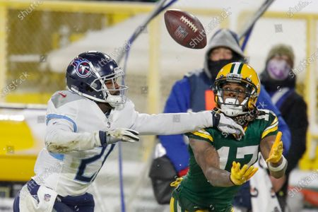 Green Bay Packers' Davante Adams catches a pass in front of Tennessee Titans' Malcolm Butler during the second half of an NFL football game, in Green Bay, Wis