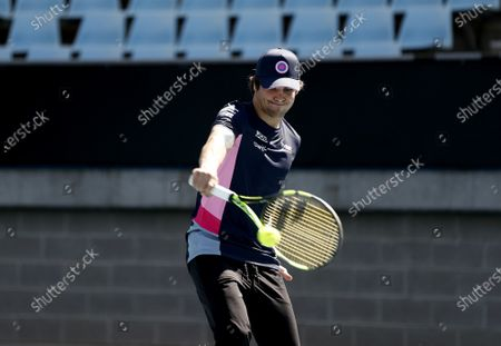 Stock Picture of Lance Stroll, Racing Point plays tennis with Lleyton Hewitt