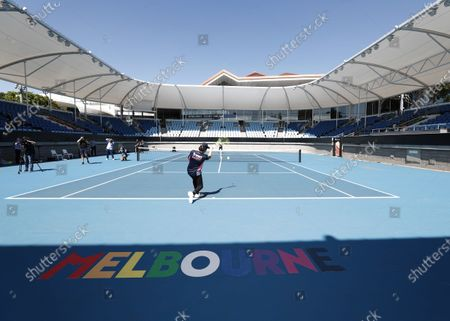 Stock Photo of Lance Stroll, Racing Point plays tennis with Lleyton Hewitt