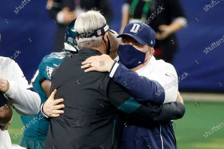 Philadelphia Eagles head coach Doug Pederson, left, and Dallas Cowboys head coach Mike McCarthy greet each other after their NFL football game in Arlington, Texas, Sunday, Dec. 27. 2020