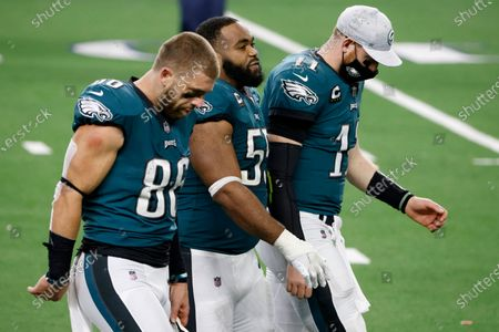 Philadelphia Eagles' Zach Ertz (86), Brandon Graham (55) and Carson Wentz (11), walk off the field after their 37-17 loss to the Dallas Cowboys in an NFL football game in Arlington, Texas, Sunday, Dec. 27. 2020