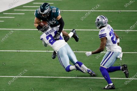 Dallas Cowboys cornerback Chidobe Awuzie (24) stops Philadelphia Eagles tight end Zach Ertz (86) from gaining extra yardage after a catch as cornerback Jourdan Lewis (26) looks on in the second half of an NFL football game in Arlington, Texas, Sunday, Dec. 27. 2020