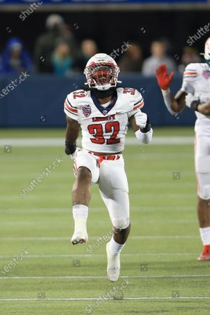Liberty linebacker Aaron Pierre (32) celebrates after a play against Coastal Carolina during the second half of the Cure Bowl NCAA college football game, in Orlando, Fla