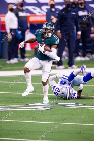 Philadelphia Eagles wide receiver DeSean Jackson (10) avoids a tackle by Dallas Cowboys cornerback Chidobe Awuzie (24) during an NFL football game, in Arlington, Texas. Dallas won 37-17