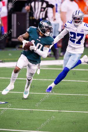 Philadelphia Eagles wide receiver DeSean Jackson (10) avoids Dallas Cowboys cornerback Trevon Diggs (27) during an NFL football game, in Arlington, Texas. Dallas won 37-17