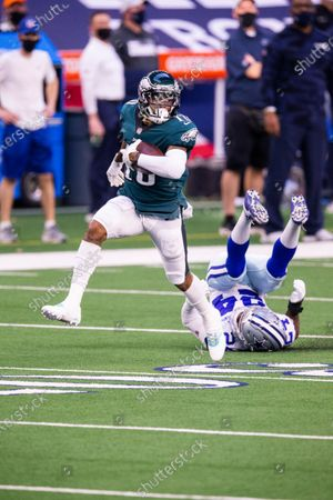 Stock Image of Philadelphia Eagles wide receiver DeSean Jackson (10) avoids a tackle by Dallas Cowboys cornerback Chidobe Awuzie (24) during an NFL football game, in Arlington, Texas. Dallas won 37-17